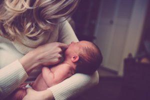 mom holding newborn infant